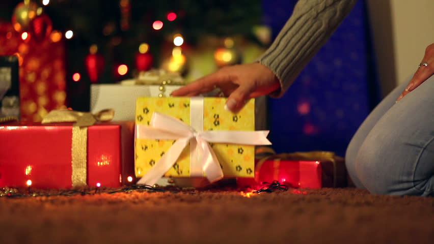 Placing a Gift under the Christmas tree