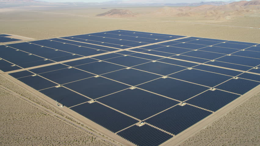 Aerial desert view Photovoltaic Solar units designed to harvest energy from the sun Las Vegas Nevada USA RED EPIC | Shutterstock HD Video #29009308