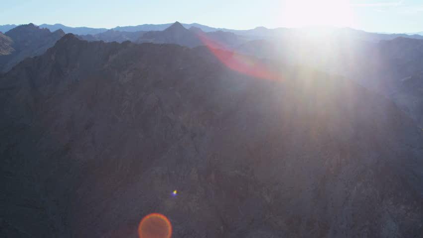 Aerial view mountain range near Las Vegas deep valleys extreme terrain sun flare Nevada USA RED EPIC | Shutterstock HD Video #29009416