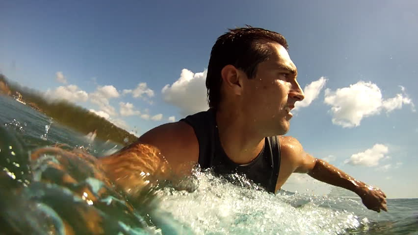 A Man Surfing in El Gigante