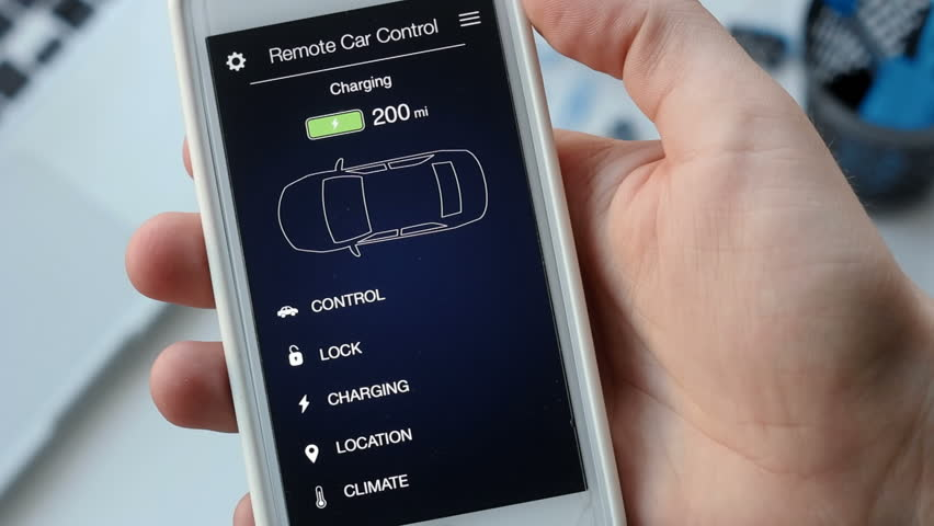 Man checks charge level of his electric car. Battery is charged. Car remote control using smartphone application fictional interface. | Shutterstock HD Video #29030539