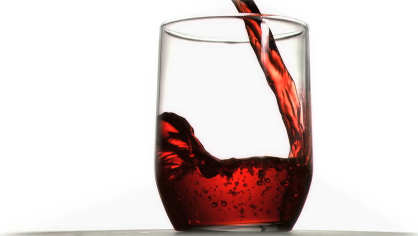 Red soda in super slow motion flowing in a glass against a white background - HD stock footage clip