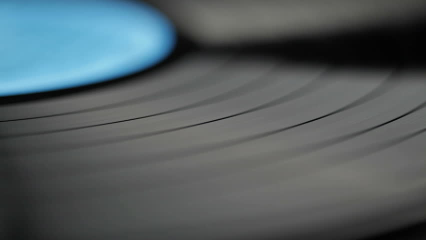 Vinyl record on turntable, viewed from above. Close-up