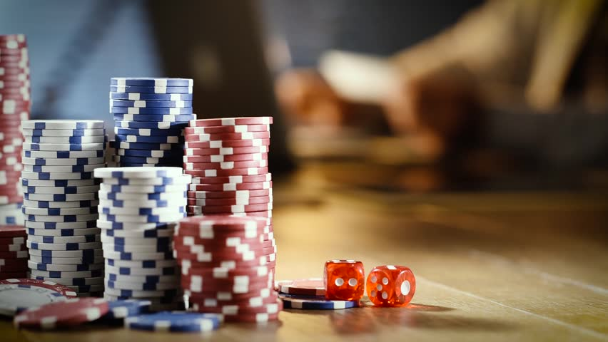 Successful man playing online casino and gambling games with his laptop late at night, piles of chips on the foreground | Shutterstock HD Video #29095240