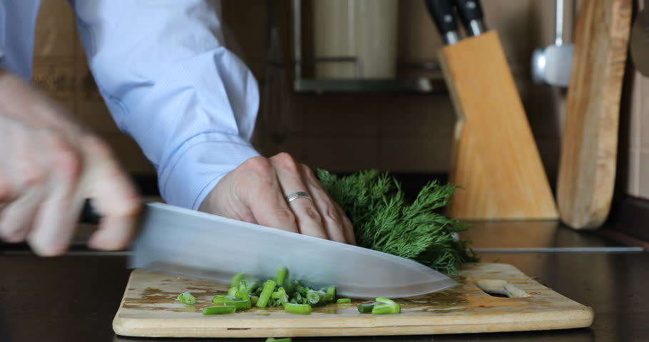 Fresh green dill chopping on wooden cutting board in the kitchen. Cutting knife #29138926