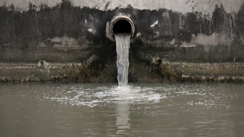 The waste water pipe from the village into the canal - HD stock footage clip