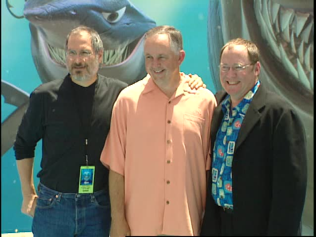 Hollywood, CA - MAY 18, 2003: Steve Jobs, John Lasseter, Richard Cook walks the red carpet at the Finding Nemo Premiere held at the El Capitan Theatre