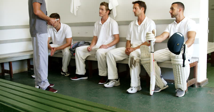 Coach interacting with cricket players in dressing room | Shutterstock HD Video #29209522