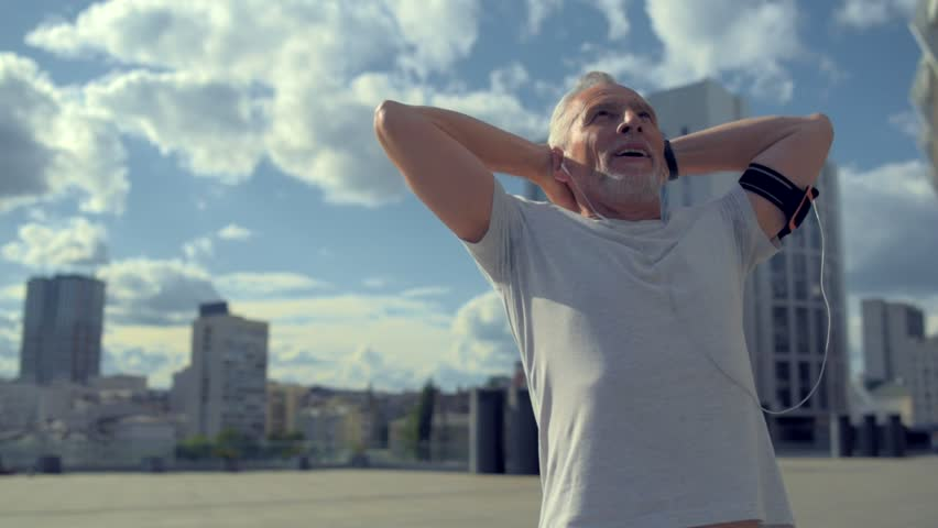 Joyful aged man enjoying sport in the city | Shutterstock HD Video #29227288