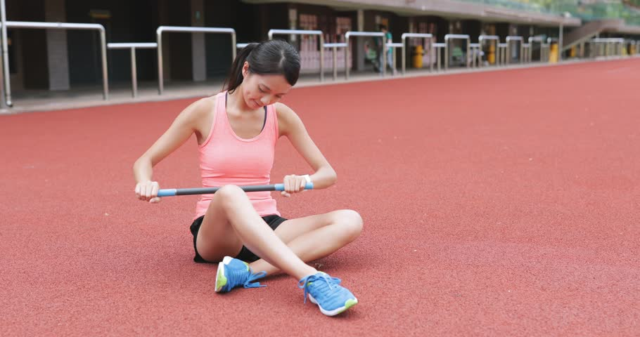 Sport woman using roller stick in sport stadium  | Shutterstock HD Video #29232670