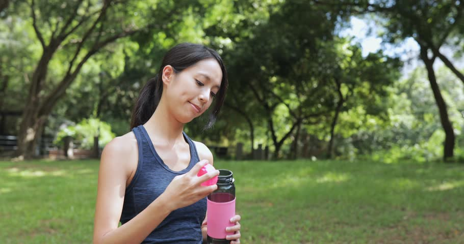 Sport woman drinking water after doing sport  | Shutterstock HD Video #29239924