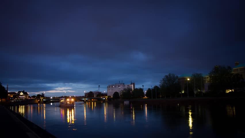 Boats lights on river timelapse