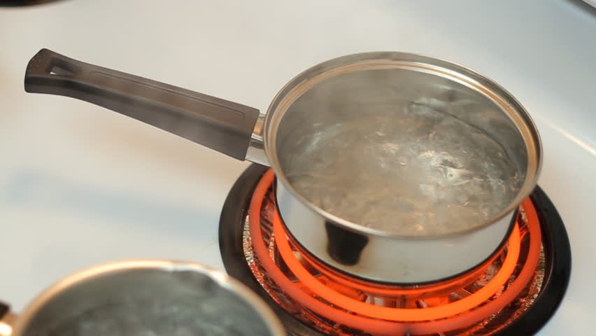 Pot Full Of Boiling Water On The Electric Stove Stock