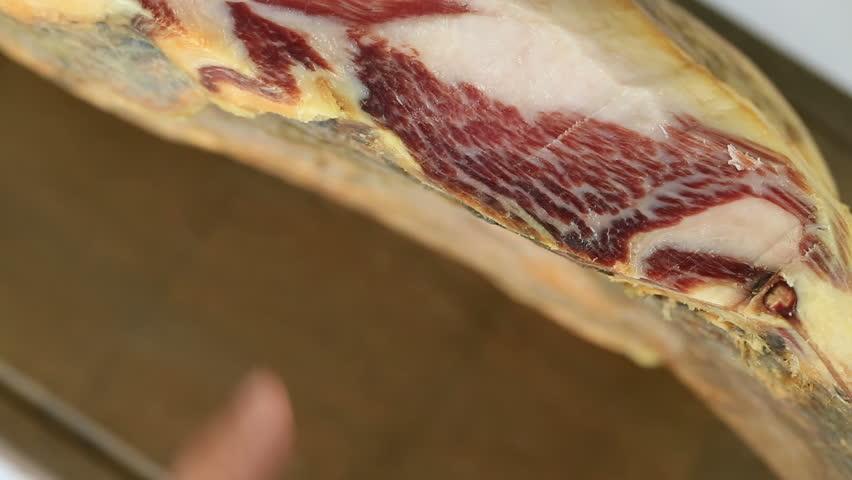 Cutting serrano ham slices