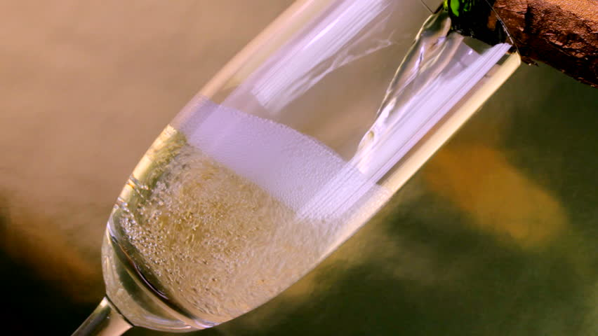 Close up of champagne being poured into flute - HD stock video clip