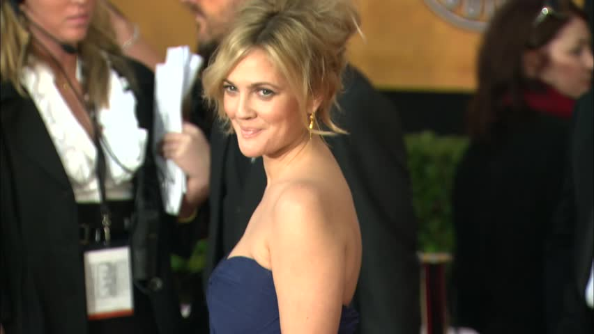 Los Angeles, CA - JANUARY 23, 2010: Drew Barrymore, walks the red carpet at the SAG Awards 2010 held at the Shrine Auditorium - HD stock footage clip