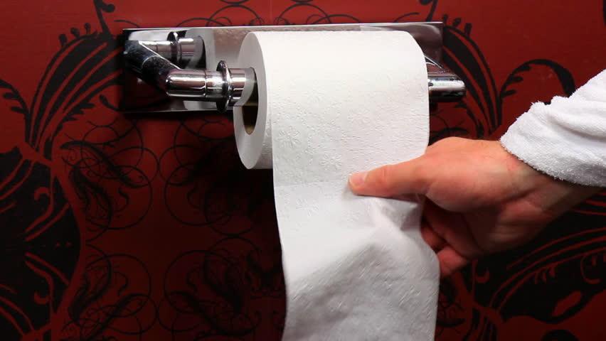 Grabbing for toilet paper - Closeup
