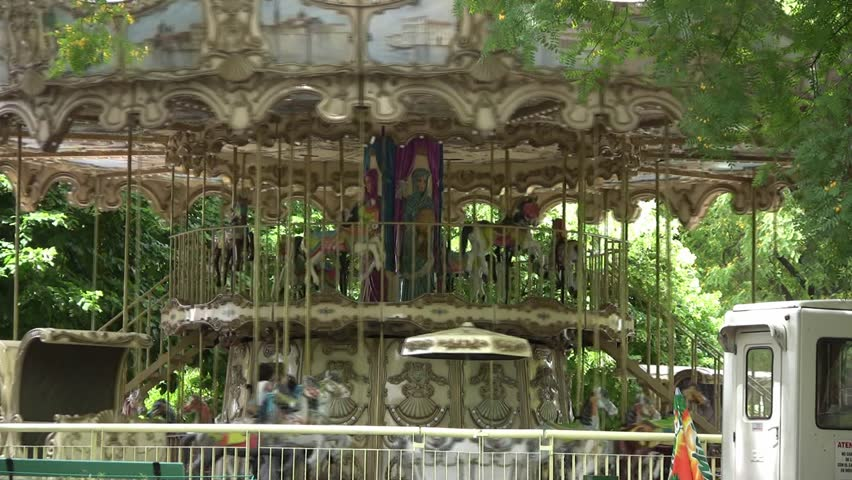 Kids carousel at Buenos Aires zoo on a quiet afternoon (source HDV 1080i, Can. HV30). - HD stock footage clip
