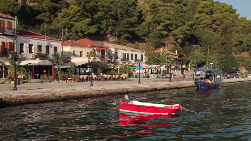 VONITSA AMBRACIAN GULF, GREECE - SEPTEMBER 29: Red pleasure boat bobs in the water at the town quay on September 29, 2012 in Vonitsa. The town is a typical picturesque Greek fishing village. - HD stock footage clip