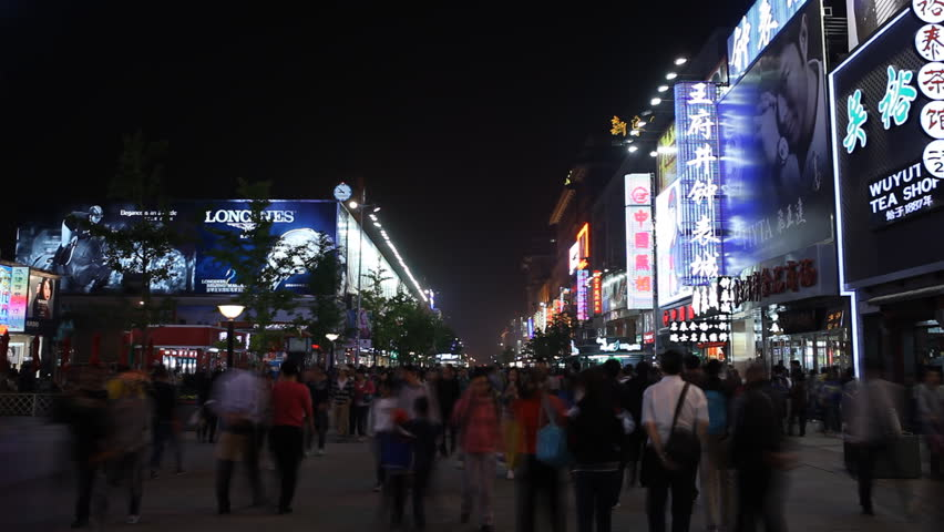 BEIJING, CHINA - APRIL 29, 2012 Shoppers on Famous Shopping Silver Street in Beijing, China, Neon Lights night, time lapse | Shutterstock HD Video #2970346