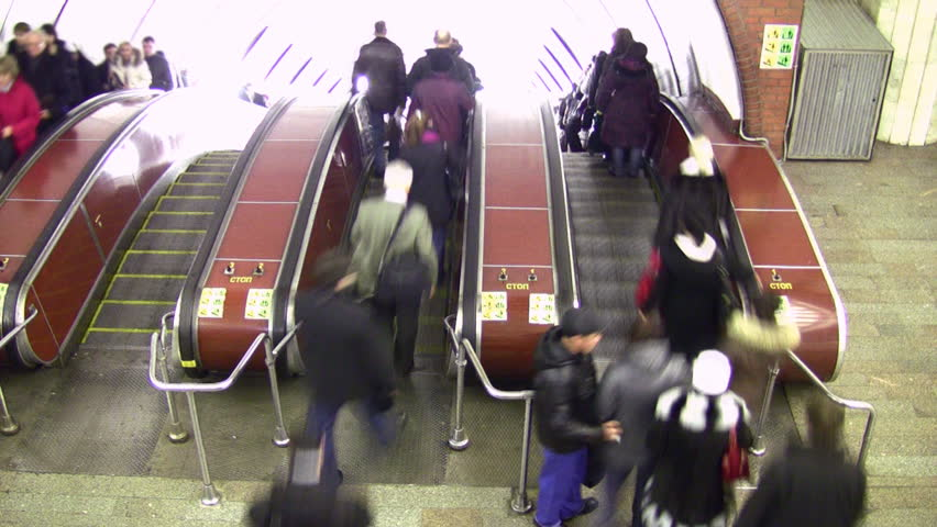 Crowd on escalator. Time lapse. Upper view.  - HD stock footage clip