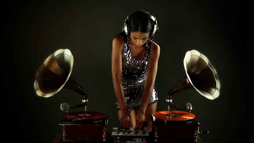 A Sexy Female Dj Dancing Topless And Playing Records Stock