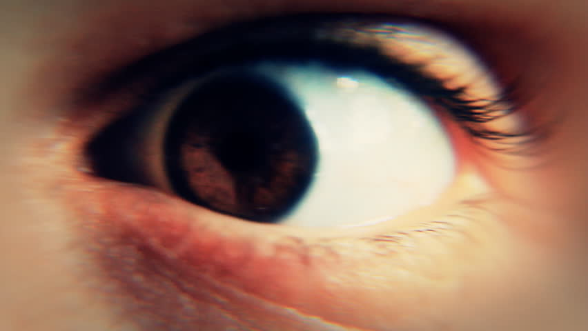 Close-up of the eye of a man awakened abruptly and having a frightened reaction,