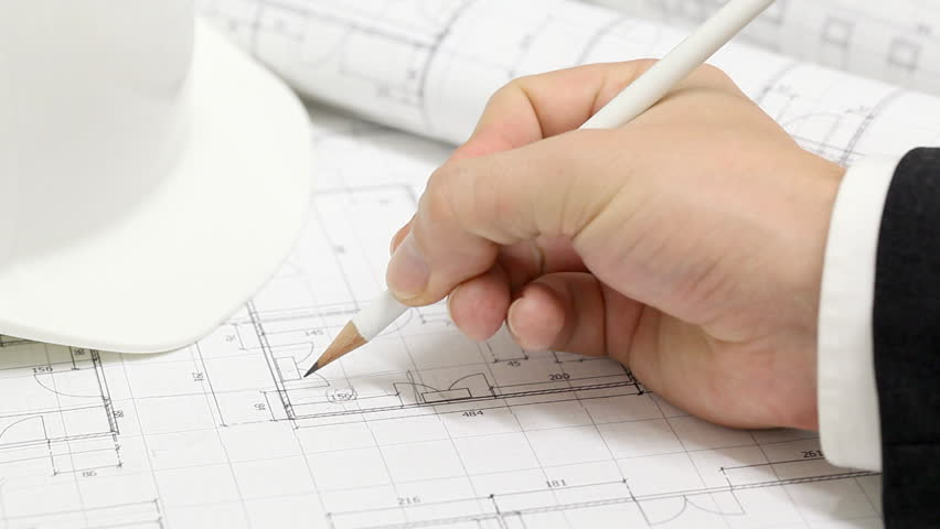 Male architect checking numbers on blueprint during house construction planing | Shutterstock HD Video #2996905