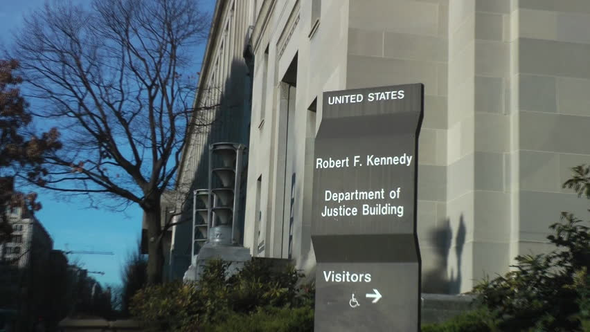U.S. Justice Department, zoom in on sign, headquarters in Washington, DC.  Renamed the Robert F. Kennedy Department of Justice Building in 2001, Constitution Ave. side.