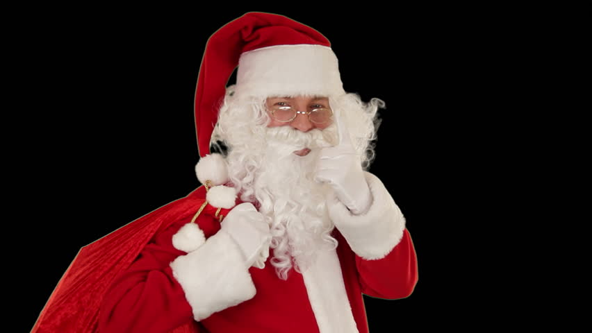 Santa Claus carrying his bag, looks at the camera sends a kiss and wave, black