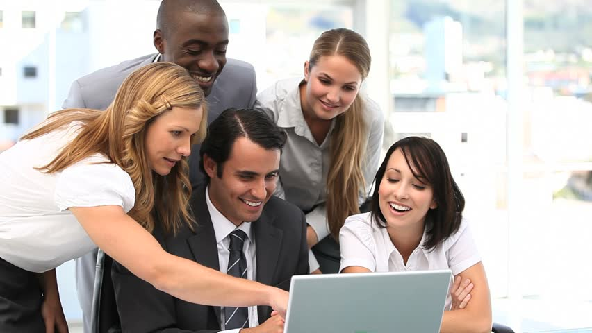 Video of a business team looking at a laptop - HD stock footage clip