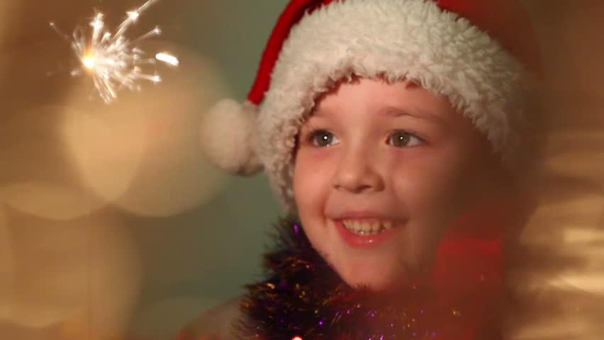 Little boy dressed as Santa Claus, soft focus   Shutterstock HD Video #3029845