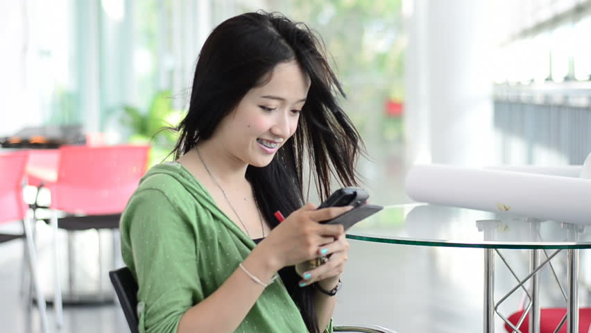 Beautiful young woman using a mobile phone