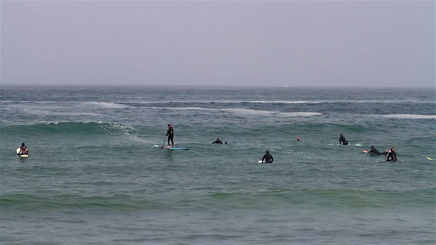 MORRO BAY - SEPT 10: Unidentified surfers waiting for the waves on Sept 10, 2012, at Morro Bay, California. Morro Bay is a popular surfing destination located along scenic Highway 1. - HD stock footage clip