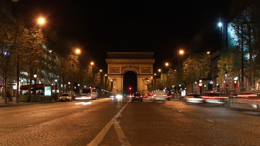 PARIS, FRANCE – APRIL 8th: Timelapse of Champs d'Elysees with Arc de Triomphe in Paris on April 8th, 2012.
