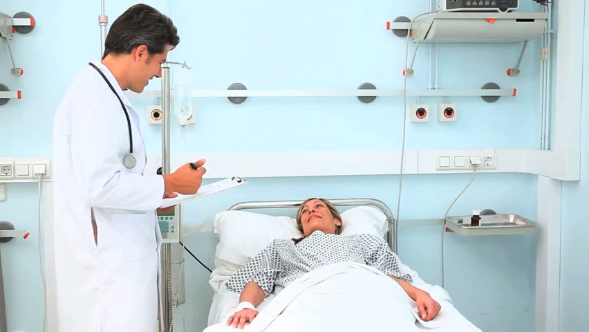 Doctor talking to his patient in hospital ward - HD stock footage clip
