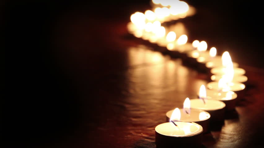 Candlelight. Little candles lined up light up one by one - HD stock video clip