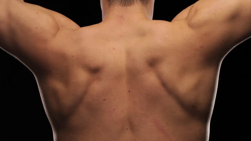 Closeup of man's back flexing - HD stock footage clip