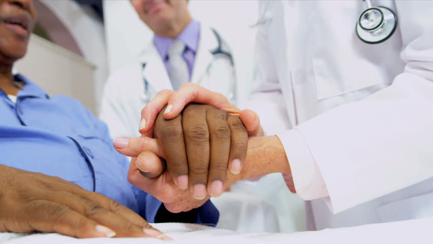 Medical Consultants Reassuring Patient | Shutterstock HD Video #3075286