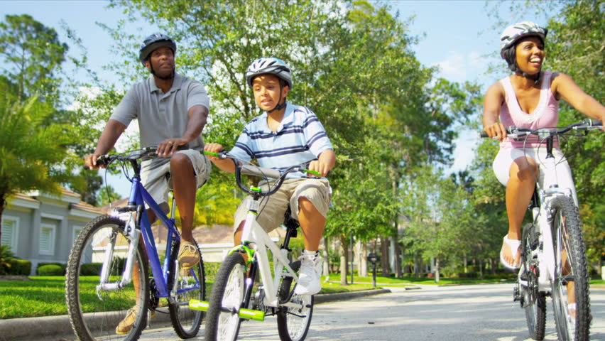 Healthy Ethnic Family Bike Riding Together - HD stock video clip