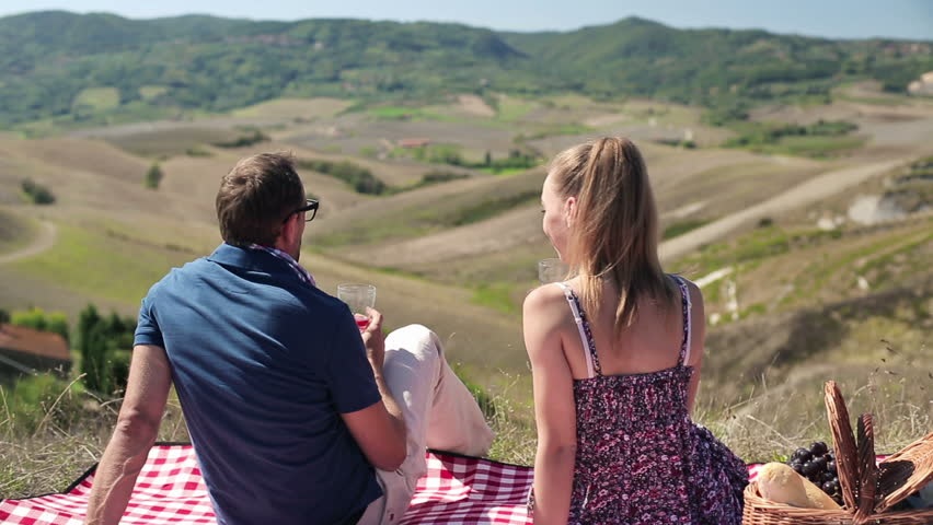 Young couple in love drinking wine on picnic, crane shot  - HD stock footage clip