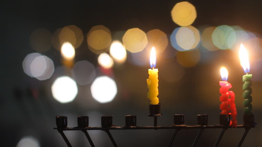 Beautiful candles and Hanukkah menorah with defocused background, dolly shot.  - HD stock footage clip