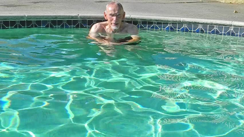 Old man swimming to side of pool stock footage video for What to do with old swimming pool