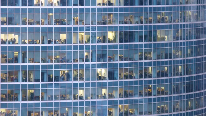 Office building viewed in the evening. Time lapse