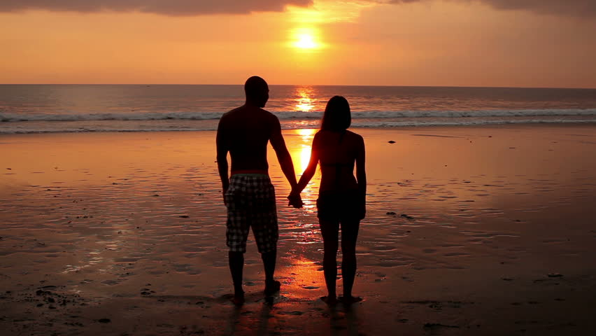 Couple Walking On Beach With Dog At Sunset In Bali Stock ...