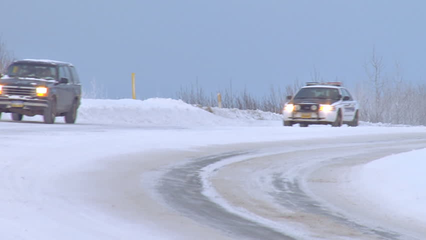 HOMER, AK - CIRCA 2012: Having a State Trooper behind you can make anyone nervous. - HD stock video clip