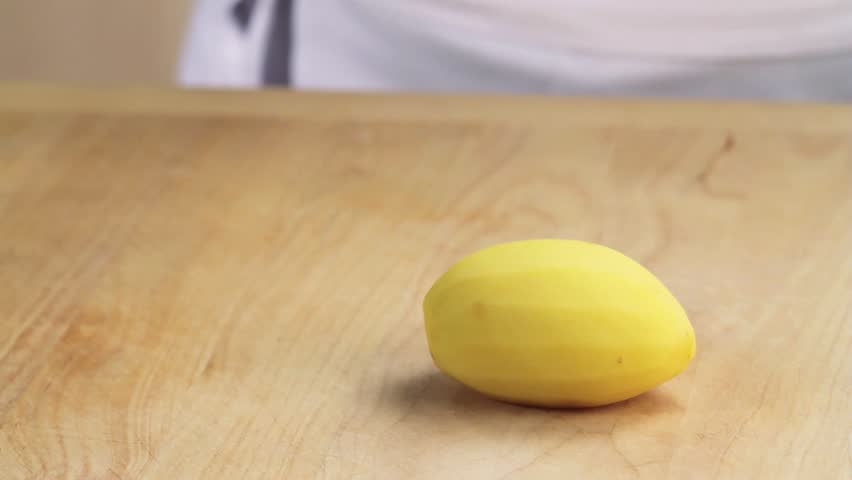 A peeled potato being halved and chopped - HD stock video clip