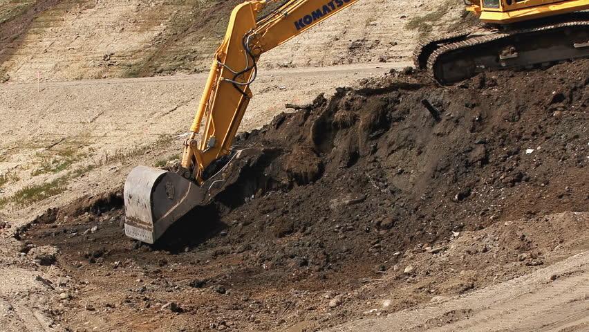 HOMER, AK - CIRCA 2012: Excavator bucket scooping earth. - HD stock footage clip