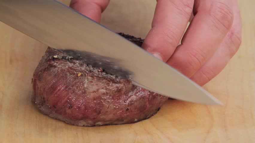 A sliced fried fillet steak (rare) - HD stock footage clip