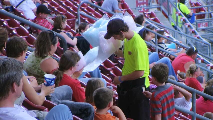 CINCINNATI - SEPTEMBER 2: Food vendor (name withheld) from Cincinnati, OH selling cotton candy during a Cincinnati Reds baseball game September 2, 2008 in Cincinnati, Ohio. - HD stock video clip